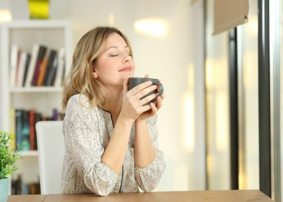 woman-looking-happy-drinking-tea.sml__1.jpg
